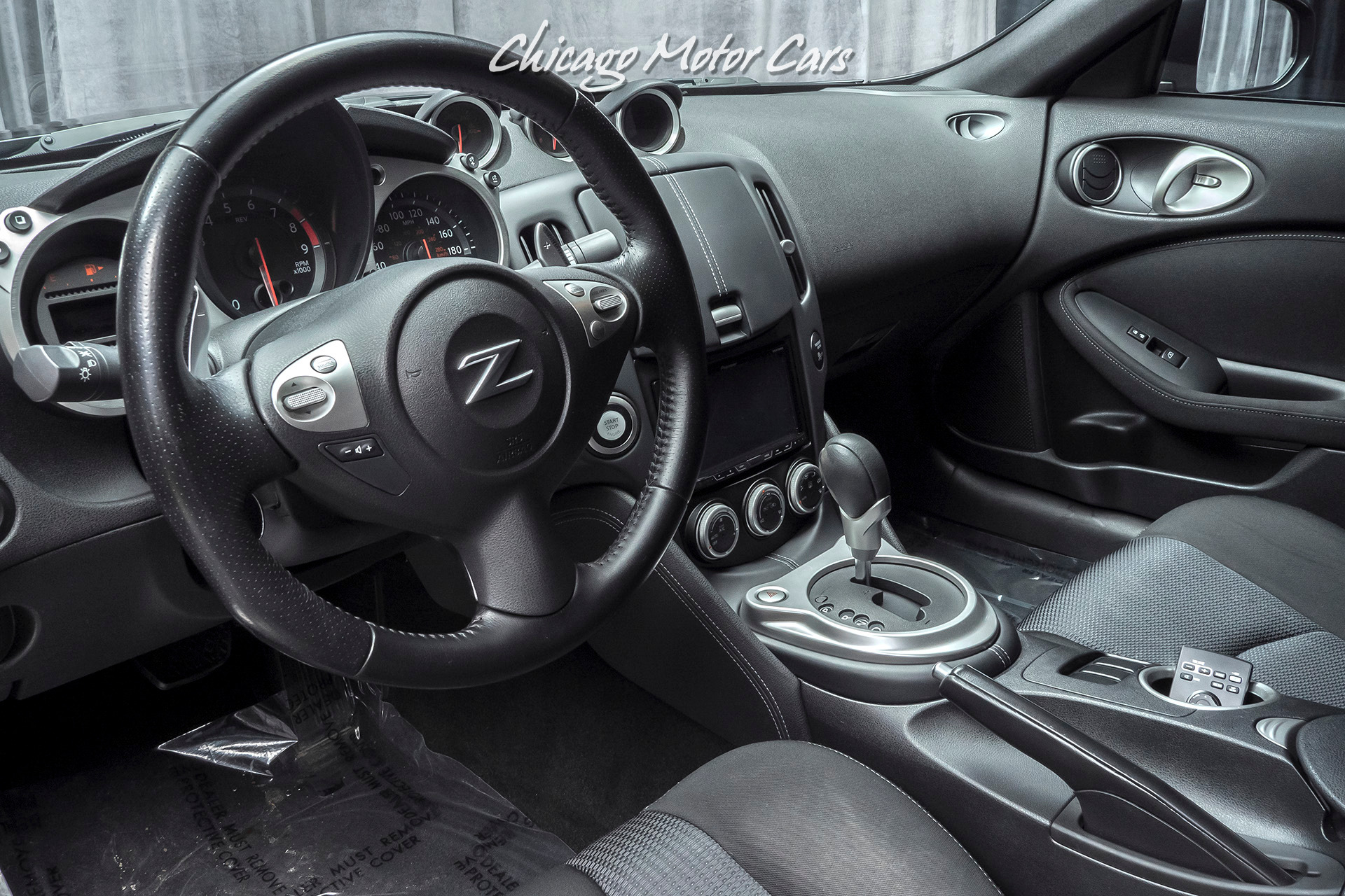 used 2013 nissan 370z coupe upgraded 19 inch wheels and headunit for sale 18 800 chicago motor cars stock 15968a used 2013 nissan 370z coupe upgraded 19